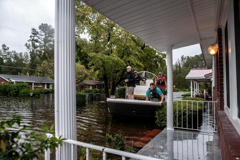 A boat crew with the Cajun Navy goes house to house to check for people in need of evacuation in Lumberton. (Joseph Rushmore for HuffPost)