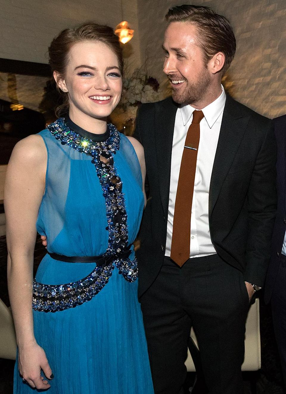 <p>The charming onscreen duo reunite for the romantic musical <em>La La Land,</em> opening in limited release this weekend before expanding Dec. 16. (Photo: Christopher Polk/Getty Images) </p>