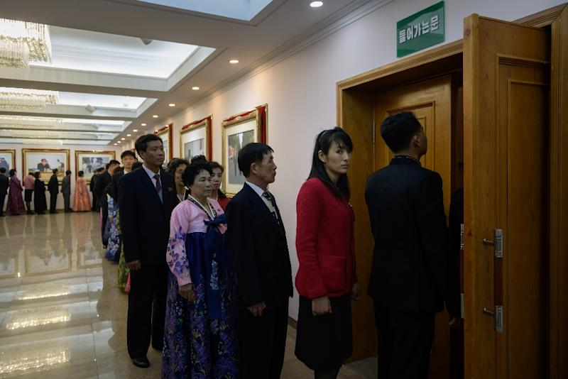 Voters queue to cast their ballots at the '3.26 Pyongyang Cable Factory' during voting for the Supreme People's Assembly elections in Pyongyang