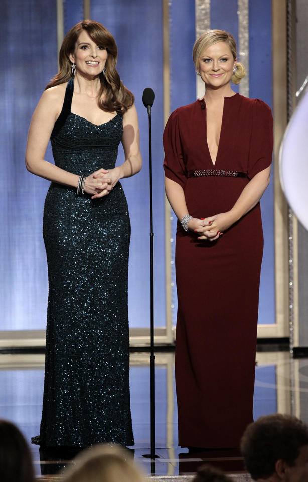 Tina Fey and Amy Poehler host the 70th Annual Golden Globe Awards at the Beverly Hilton on January 13, 2013 in Beverly Hills, California.