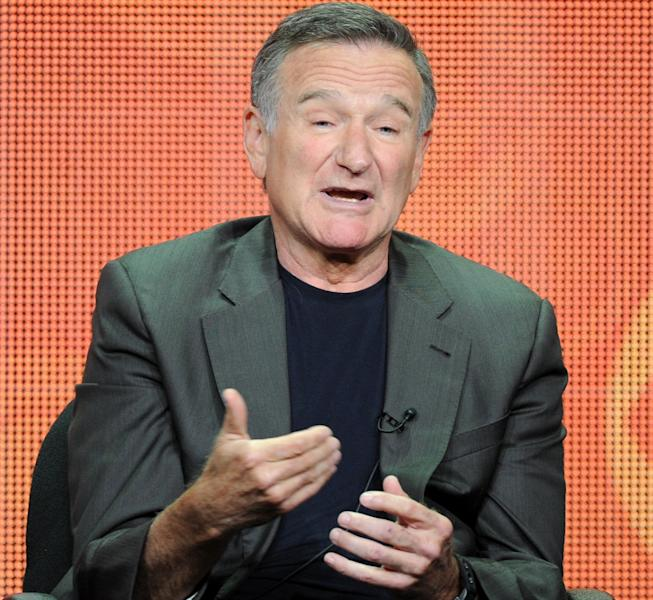 """FILE - In this July 29, 2013 file photo, actor Robin Williams participates in the """"The Crazy Ones"""" panel at the 2013 CBS Summer TCA Press Tour at the Beverly Hilton Hotel in Beverly Hills, Calif. The Nielsen company said Friday, Sept. 27, 2013, that Williams' new CBS comedy, """"The Crazy Ones,"""" debuted before 15.6 million people on Thursday night. It competed directly at 9 p.m. Eastern with """"The Michael J. Fox"""" on NBC, which was seen by 7.2 million people. (Photo by Frank Micelotta/Invision/AP, File)"""