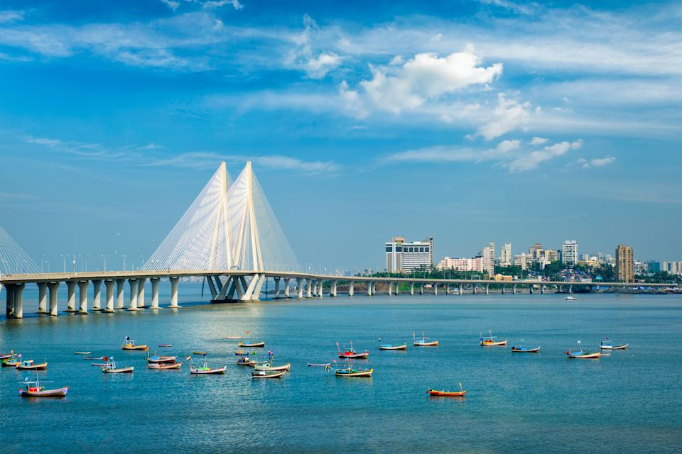 Mumbai skyline Bandra - Worli Sea Link bridge with fishing boats view from Bandra fort. Mumbai, Maharashtra, India