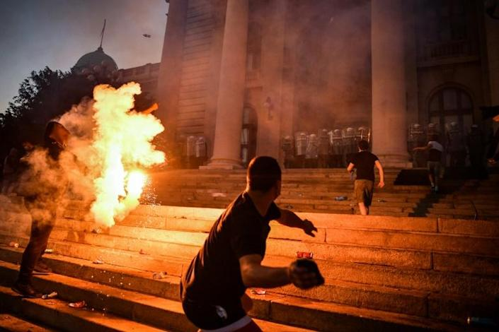 Protesters clashed with police during a demonstration in Belgrade against a weekend curfew to combat a resurgence of COVID-19 infections