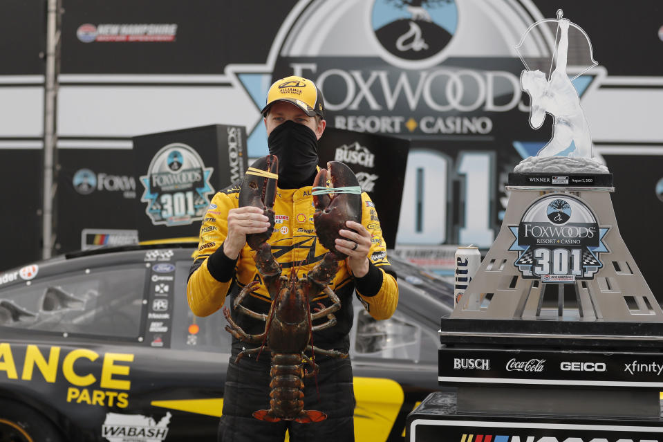 Brad Keselowski holds a giant lobster to celebrate his victory in Loudon, New Hampshire.