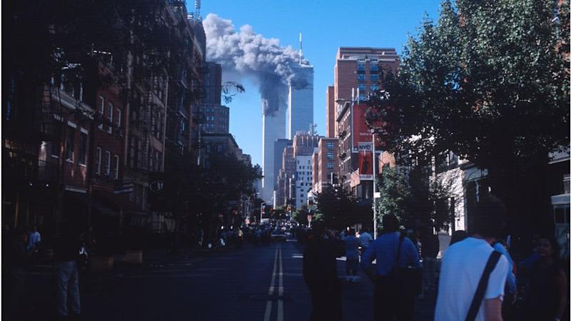 Smoke from the burning World Trade Center towers fills up the downtown Manhattan skyline