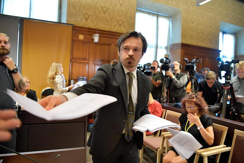 Court staff hand out the verdict to press (AFP/Getty Images)