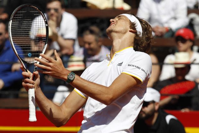 Germany's Alexander Zverev reacts during his match against Spain's Rafael Nadal during a World Group Quarter final Davis Cup tennis match between Spain and Germany at the bullring in Valencia, Spain, Sunday April 8, 2018. (AP Photo/Alberto Saiz)