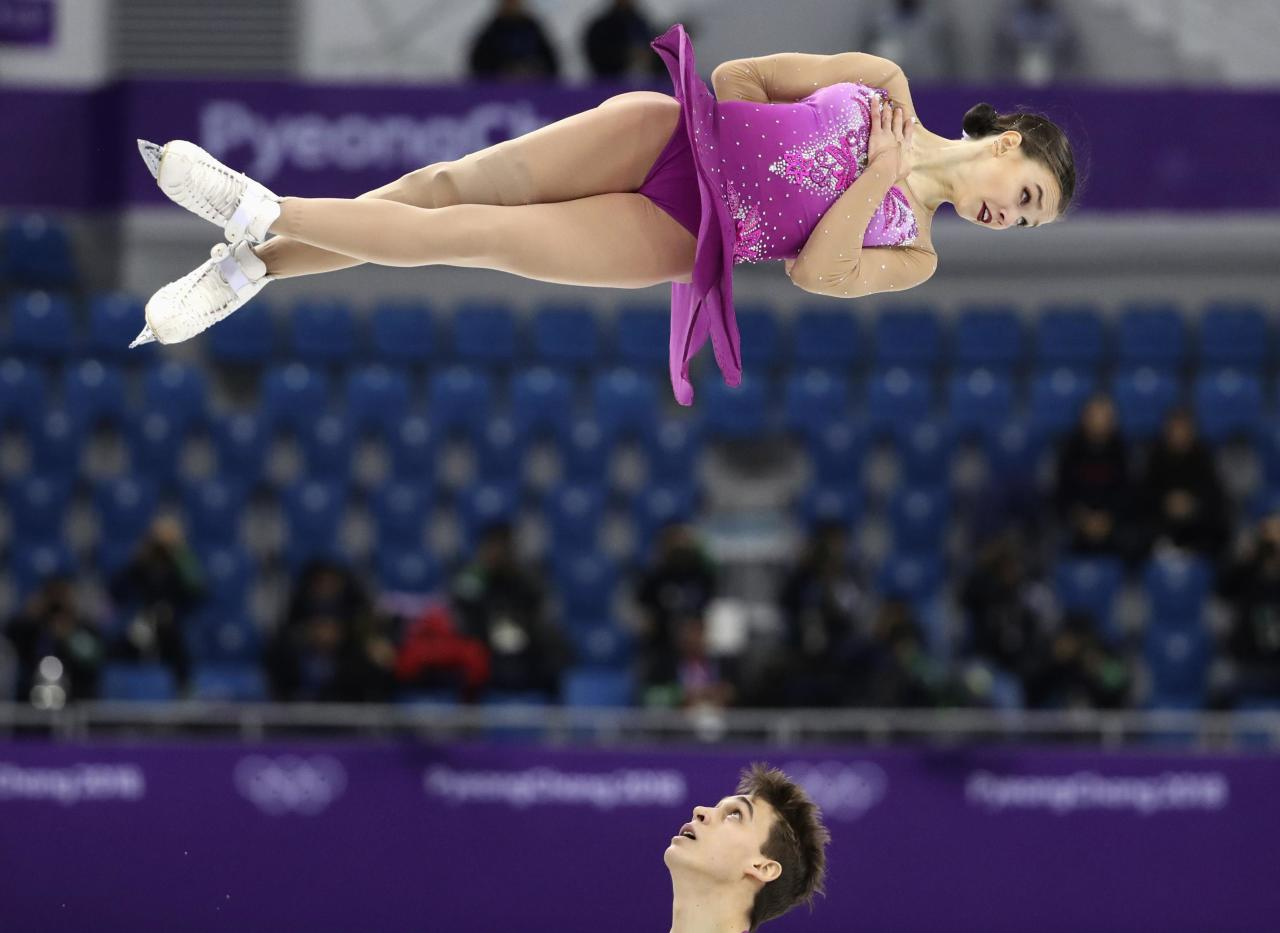 <p>Anna Duskova and Martin Bidar of Czech Republic in action. REUTERS/Lucy Nicholson </p>