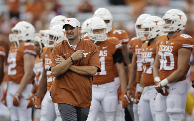Tom Herman's Texas Longhorns will be in the Big-12 title game with a win over Kansas next week. (AP)