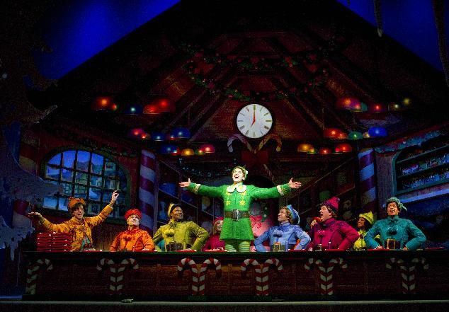 """This publicity image released by The Hartman Group shows the cast in a scene from the Christmas musical """"Elf"""" in New York.  The hit musical ELF will return to Broadway this holiday season at the Al Hirschfeld Theatre. Performances will begin on Friday, Nov. 9, 2012.  The production will play a limited engagement of 9 weeks for the holiday season through Sunday, Jan. 6, 2013. (AP Photo/The Hartman Group, Joan Marcus)"""