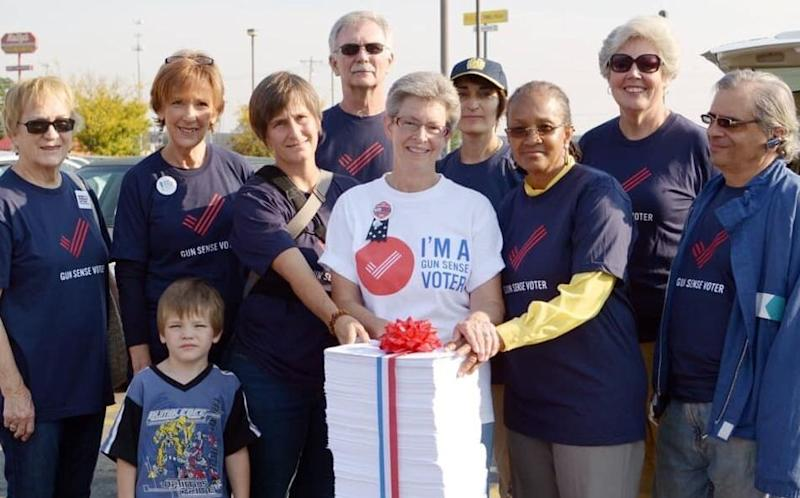 Michele Mueller, center, and other volunteers for Moms Demand Action took a giant stack of petitions to a Kroger in Cincinnati in 2014 to ask the grocery chain to stop allowing open carry. (Photo: Moms Demand Action)