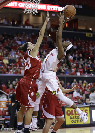 Maryland guard Laurin Mincy, right, shoots over Indiana guard Alexis Gassion in the second half of an NCAA college basketball game, Thursday, Feb. 26, 2015, in College Park, Md. Mincy contributed a game-high 28 points to Maryland's 83-72 win. (AP Photo/Patrick Semansky)