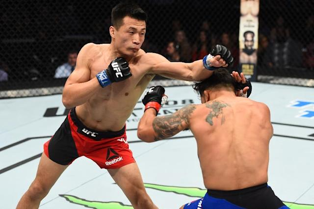 Chan Sung-jung says MMA can have a positive impact (AFP Photo/Jeff BOTTARI)