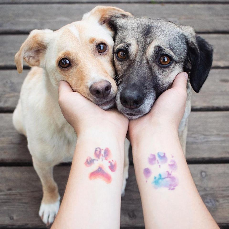 If you're a dog lover, this is the watercolor tattoo you need in your life.