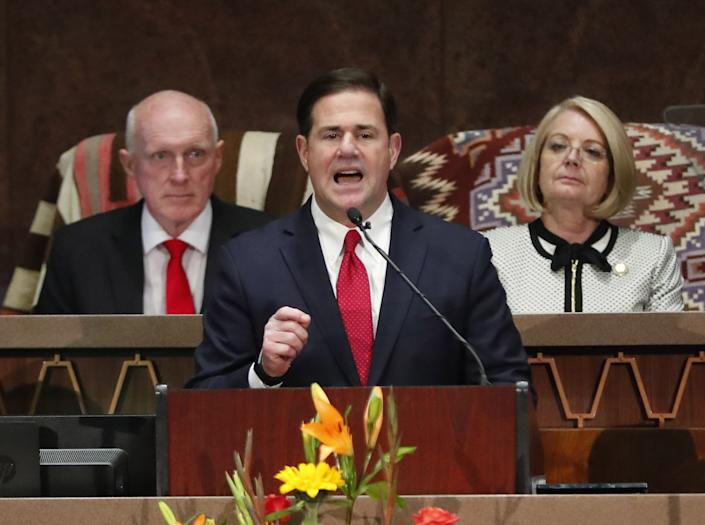 Gov. Doug Ducey delivers his State of the State address with House Speaker Rusty Bowers and Senate President Karen Fann behind him at the Arizona Capitol on Jan. 13, 2020.