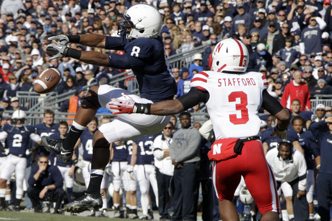 Penn State receiver Allen Robinson (8) can't handle a pass from quarterback Matt McGloin in front of Nebraska safety Daimion Stafford (3) during the first quarter of an NCAA college football game in State College, Pa., Saturday, Nov. 12, 2011. (AP Photo/Gene J. Puskar)