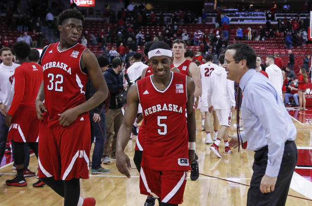 Nebraska head coach Tim Miles reacts to his players Jordy Tshimanga (32) and Glynn Watson (5) after Nebraska's 74-63 win over Wisconsin in an NCAA college basketball game Monday, Jan. 29, 2018, in Madison, Wis. (AP Photo/Andy Manis)