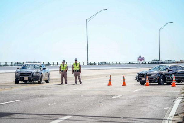 PHOTO: Florida State Troopers block traffic over the Bayou Grande Bridge leading to the Pensacola Naval Air Station following a shooting on December 06, 2019 in Pensacola, Florida. (Josh Brasted/Getty Images)