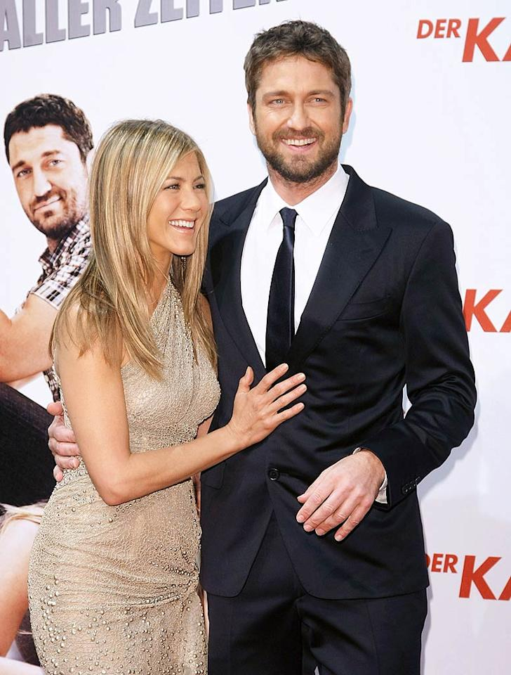 """<i>OK!</i> magazine announced that Jennifer Aniston has decided this is the year she'll get pregnant, and has chosen Gerard Butler to be the father. What's more, the tab has even """"confirmed"""" that a baby's on the way! See if <a href=""""http://www.gossipcop.com/jennifer-aniston-gerard-butler-baby/"""" target=""""new"""">Gossip Cop</a> is """"on board"""" with this baby rumor. Florian Seefried/<a href=""""http://www.gettyimages.com/"""" target=""""new"""">GettyImages.com</a> - March 29, 2010"""