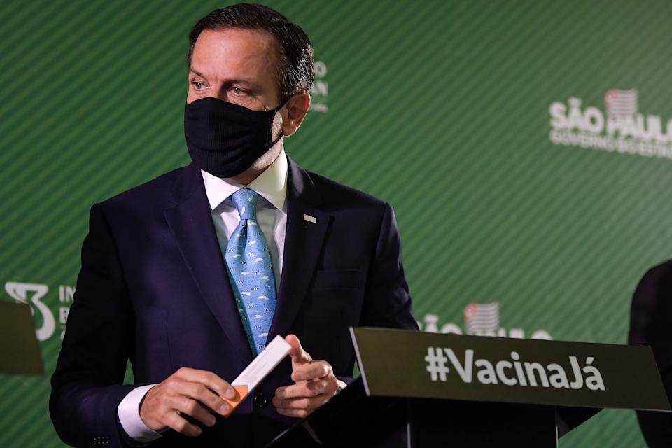 Sao Paulo Governor Joao Doria holds a package of the CoronaVac vaccine during a press conference at Butantan's headquarters in Sao Paulo, Brazil, on January 7, 2021. - The Butantan Institute announced today that the effectiveness of the CoronaVac vaccine, developed in partnership with the Chinese laboratory Sinovac, is 78% against COVID-19, and that it has already initiated the request for emergency use of the immunizer by ANVISA (National Health Surveillance Agency). (Photo by NELSON ALMEIDA / AFP) (Photo by NELSON ALMEIDA/AFP via Getty Images)