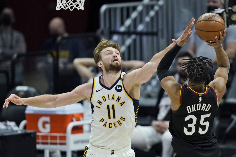 Indiana Pacers' Domantas Sabonis (11) blocks a shot by Cleveland Cavaliers' Isaac Okoro (35) in the second half of an NBA basketball game, Monday, May 10, 2021, in Cleveland. (AP Photo/Tony Dejak)