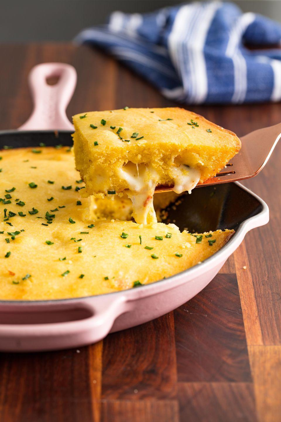 """<p>This isn't your ordinary cheesy cornbread. It's cornbread <em>STUFFED</em> with an entire layer of cheese.</p><p>Get the recipe from <a href=""""https://www.delish.com/cooking/recipe-ideas/recipes/a48772/cheese-stuffed-cornbread/"""" rel=""""nofollow noopener"""" target=""""_blank"""" data-ylk=""""slk:Delish"""" class=""""link rapid-noclick-resp"""">Delish</a>.</p>"""