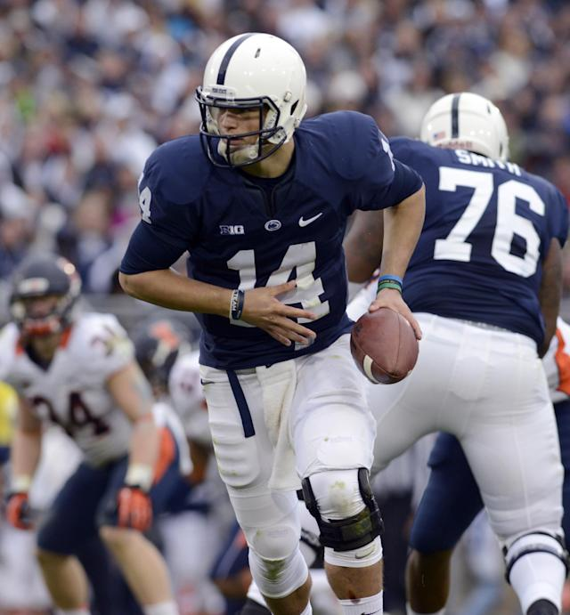 Penn State quarterback Christian Hackenberg (14) hands off the ball in the second half of an NCAA college football game against Illinois in State College, Pa., Saturday, Nov. 2, 2013. (AP Photo/John Beale)