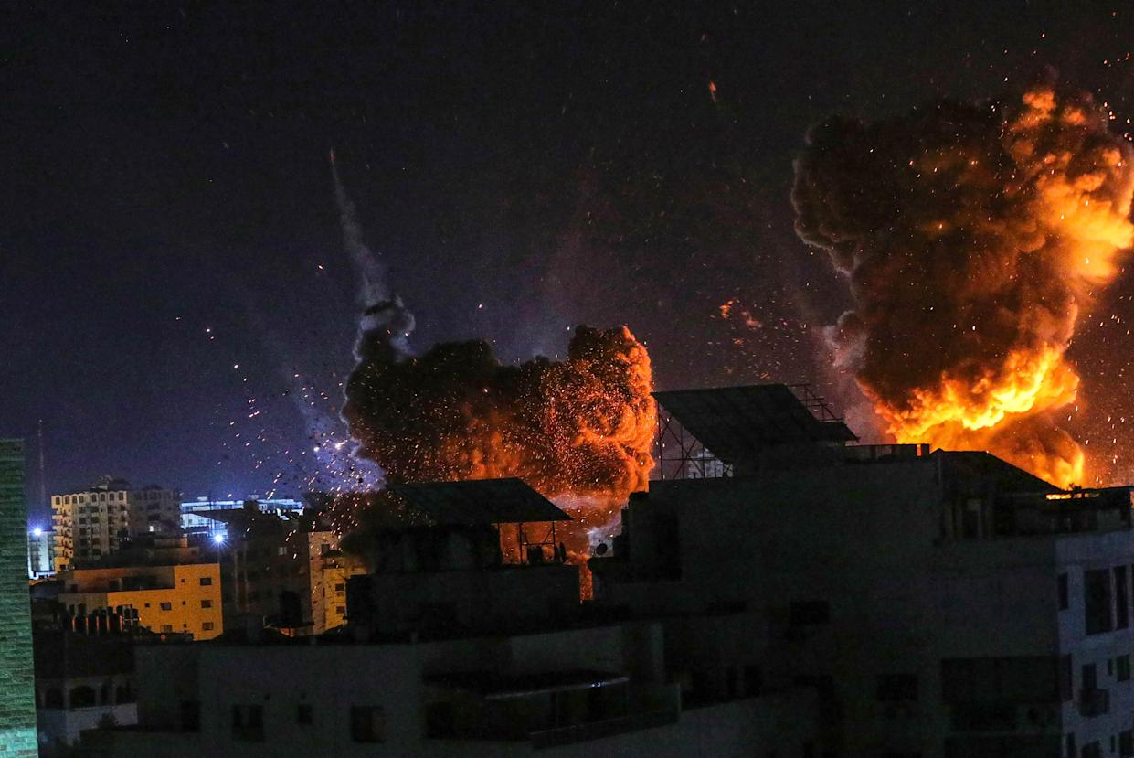 Fire and smoke rise above buildings in Gaza City as Israeli warplanes target a governmental building, early on May 18, 2021 in Gaza City, Gaza. (Fatima Shbair/Getty Images)