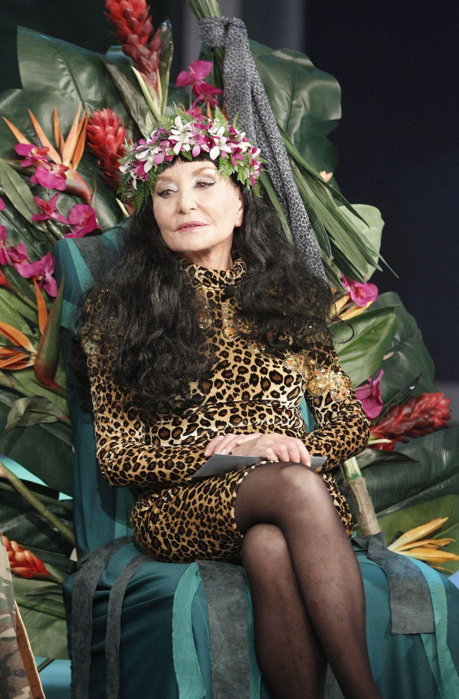 <p>The media pioneer roared in leopard and her flower crown on a throne as pop royalty Katy Perry.</p>