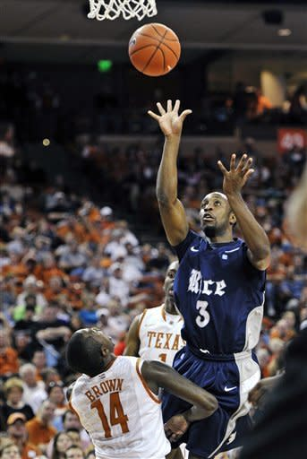 Rice guard Tamir Jackson (3) puts up a shot against Texas guard J'Covan Brown (14) during the first half of an NCAA college basketball game, Saturday, Dec. 31, 2011, in Austin, Texas. (AP Photo/Michael Thomas)