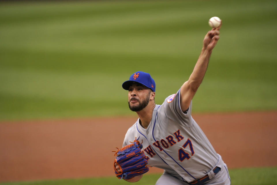 New York Mets starting pitcher Joey Lucchsi delivers a pitch during the first inning of the team's baseball game against the Washington Nationals, Friday, June 18, 2021, in Washington. (AP Photo/Carolyn Kaster)