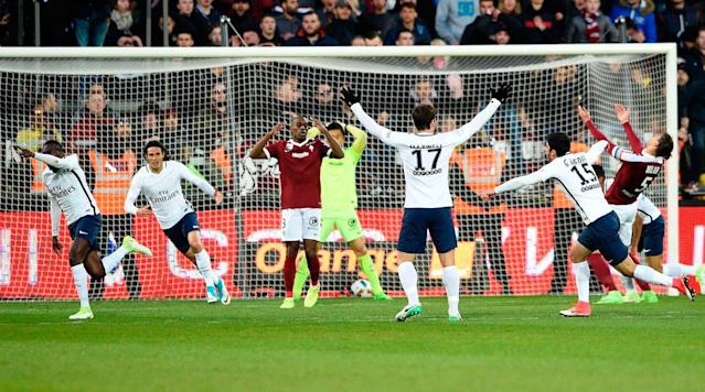 PARIS (AP) Midfielder Blaise Matuidi rescued Paris Saint-Germain with an injury-time winner as the French champions won 3-2 away to Metz to keep the pressure on league leader Monaco on Tuesday.