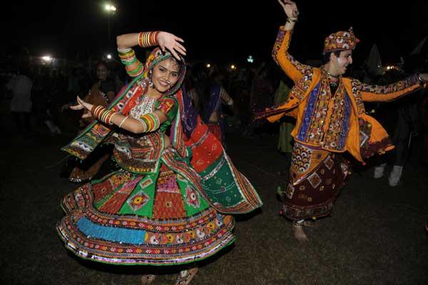 Indian dancers perform a traditional dance on the last day of Navratri late on October 5, 2011. Navratri or Festival of Dance started on September 28 and will conclude on October 6. AFP PHOTO / Sam PANTHAKY