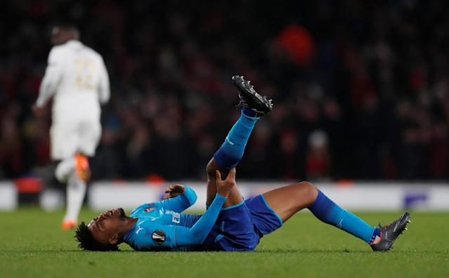 Soccer Football - Europa League Round of 32 Second Leg - Arsenal vs Ostersunds FK - Emirates Stadium, London, Britain - February 22, 2018 Arsenal's Alex Iwobi holds his leg Action Images via Reuters/Peter Cziborra