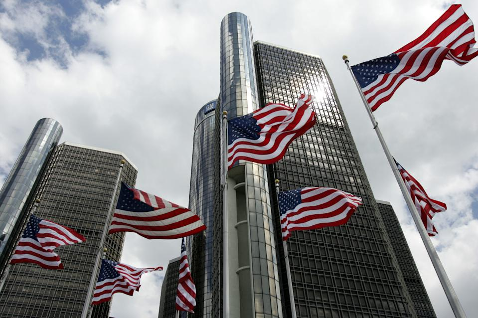 American flags fly in front of General Motors headquarters in downtown Detroit, Michigan, in 2005. (Photo: REUTERS/Rebecca Cook RC/KS)