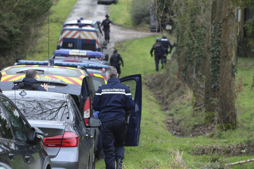 In this photo providedby the French Gendarmerie, gendarmes are deployed, near Lieruon, Brittany, France, Saturday, Jan. 2, 2021. A French prosecutor said police detained seven people Saturday, including two alleged organizers, after a New Year's Eve rave party drew at least 2,500 people in western France despite a coronavirus curfew and other restrictions. (Gendarmerie Nationale via AP)