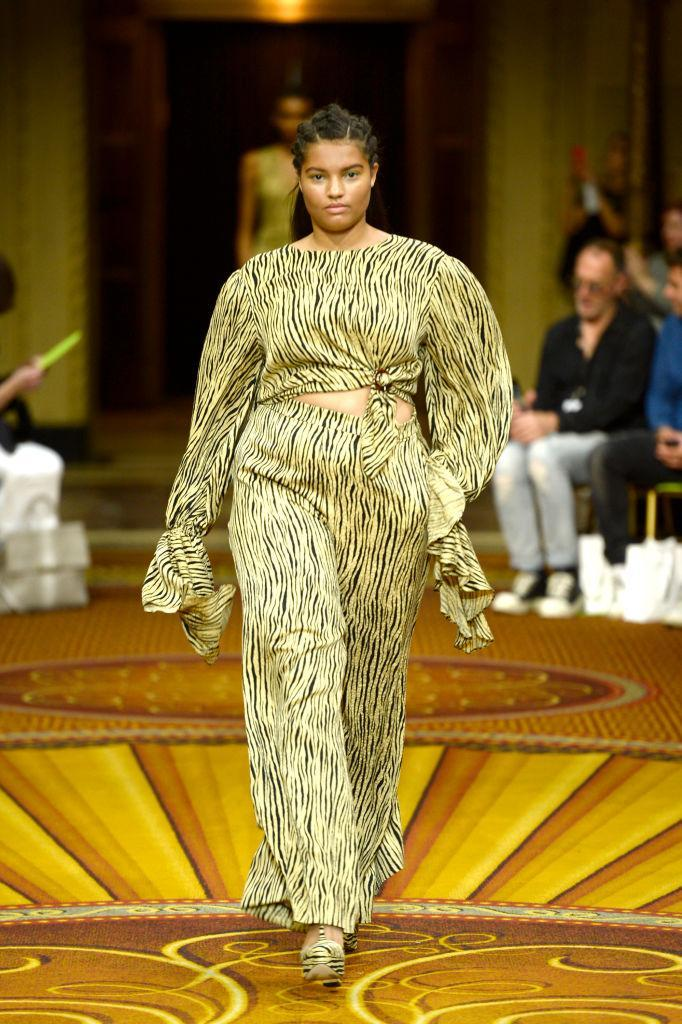 <p>A curvy model walks Christian Siriano's spring 2019 show wearing a tiger print cropped blouse and matching wide-leg trousers during New York Fashion Week. (Photo: Getty Images) </p>