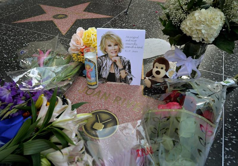 Flowers are placed on the Hollywood Walk of Fame Star for Joan Rivers, in Hollywood, California, on September 4, 2014, following news of the comedian's death in New York at the age of 81 (AFP Photo/Mark Ralston)
