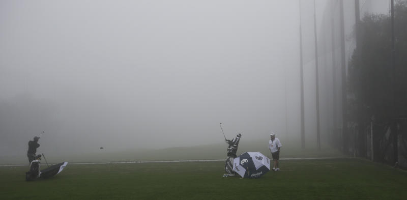 Several players warm up for the fog-delayed start to the third round of Farmers Insurance Open golf tournament, Saturday, Jan. 26, 2013, in San Diego. (AP Photo/Lenny Ignelzi)