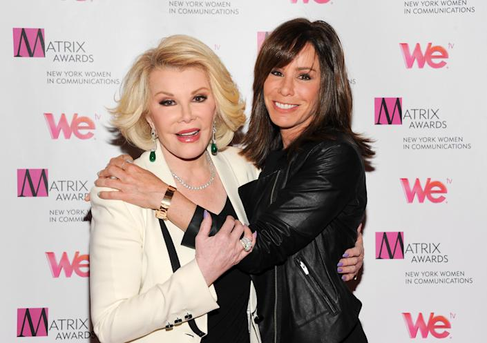 """FILE - In this April 22, 2013 file photo, Television personalities Joan Rivers, left, and daughter Melissa Rivers attend the 2013 Matrix New York Women in Communications Awards at the Waldorf-Astoria Hotel, in New York. Attorneys for two women held in a Cleveland home and abused for a decade say Joan Rivers should apologize for comparing living in her daughter's guest room with the captivity they experienced. Rivers and her daughter were discussing their reality show Tuesday, April 22, 2014, on NBC's """"Today"""" show when she complained about her living arrangements, saying, """"Those women in the basement in Cleveland had more space."""" (Photo by Evan Agostini/Invision/AP, file)"""