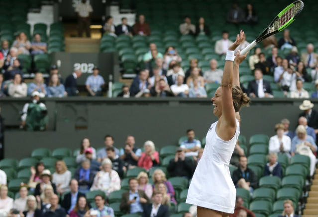 Czech Republic's Barbora Strycova, right, and Taiwan's Su-Wei Hsieh celebrate defeating Canada's Gabriela Dabrowski and China's Yifan Xu in the women's doubles final match of the Wimbledon Tennis Championships in London, Sunday, July 14, 2019. (AP Photo/Tim Ireland)