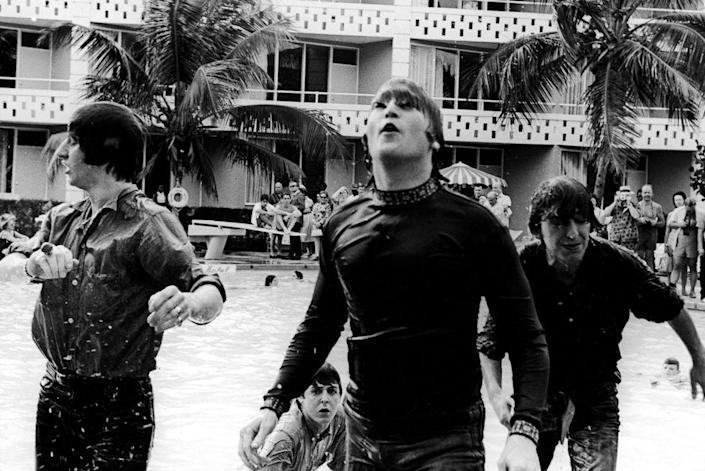 <p>The Beatles climb out of a pool while filming a movie, tentatively called, <em>Beatles 2</em>, in the Bahamas in 1965.</p>