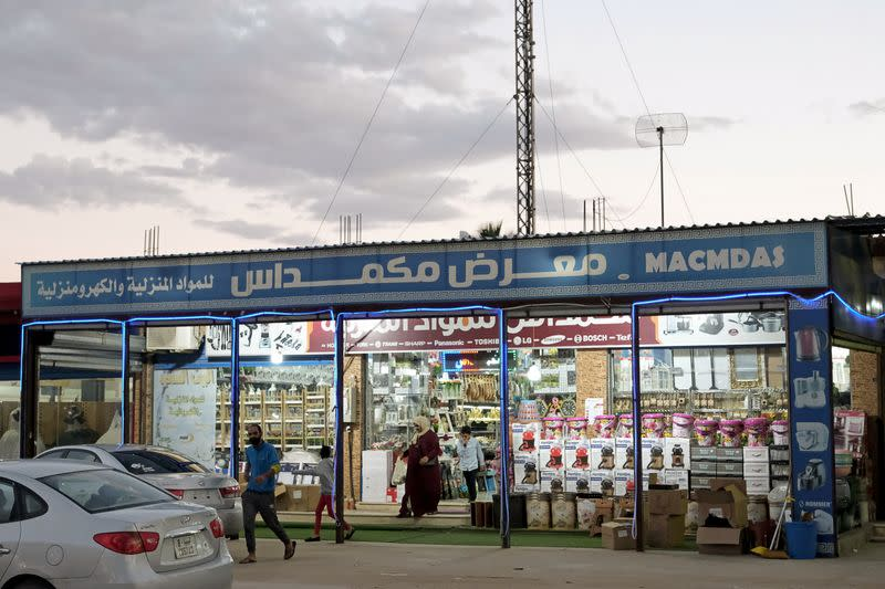 People leave a store in Sirte