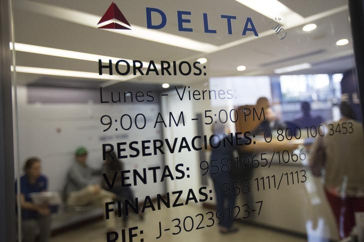 Customers wait their turn to be served at at the Delta airlines office in Caracas