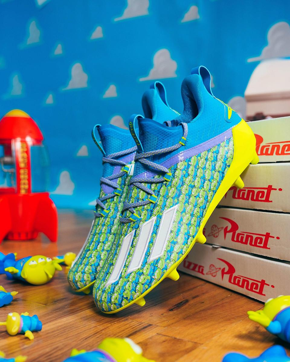 <p>Your kids will love channeling their inner <strong>Toy Story</strong> character while wearing the Adidas Aliens x Adizero Football Cleats.</p>