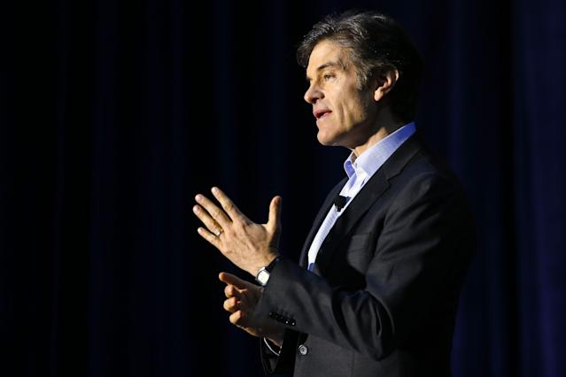 Dr. Mehmet Oz speaks during a safety clinic hosted by the NFL and the Chicago Bears for mothers of youth football players, Tuesday, Oct. 29, 2013, at Halas Hall in Lake Forest, Ill. (AP Photo/Andrew A. Nelles)
