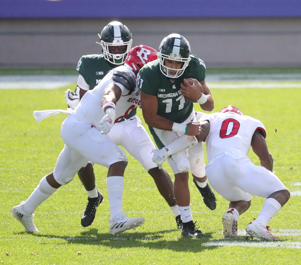 Michigan State running back Connor Heyward is tackled by Rutgers defensive back Christian Izien during MSU's 38-27 loss on Saturday, Oct. 24, 2020, at Spartan Stadium.