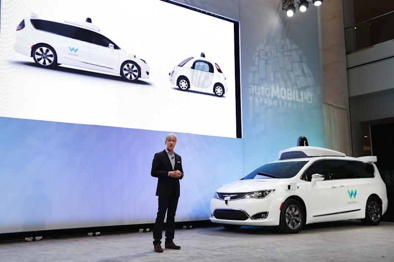 John Krafcik, CEO of Waymo Inc., the autonomous vehicle company created by Google's parent company, introduces a Chrysler Pacifica hybrid outfitted with Waymo's own suite of sensors and radar at the North American International Auto Show in Detroit, Sunday, Jan. 8, 2017. (AP Photo/Paul Sancya)