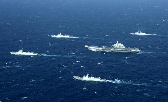 Chinese navy ships, including the aircraft carrier Liaoning, during military drills in the South China Sea (AFP Photo/STR)