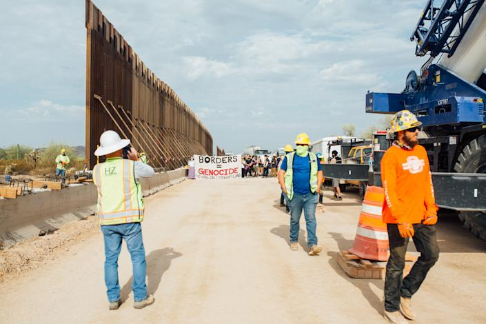 Construction workers at the construction site of the border wall along the reservation near Quitobaquito on Sept. 21, 2020, in Organ Pipe Cactus National Park.
